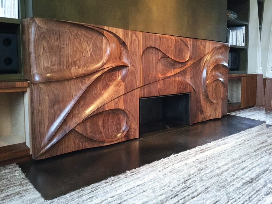 Tornado fireplace surround in American Black Walnut
