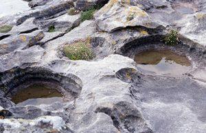 Potholes on eroded nodules, Laig Bay, Eigg
